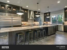 modern kitchen with brown cabinets modern kitchen brown image photo free trial bigstock
