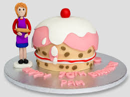 giant cupcake cake and mum baker with rolling pin cake topper
