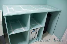 diy laundry folding table diy folding table and basket storage for the laundry room hometalk