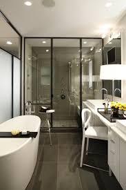 bathroom contemporary bathroom with dark tile flooring plus glass