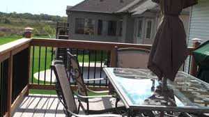 grey trex decking with cedar railing rim and decorative post