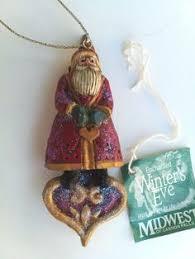 pam schifferl winter s santa on moon ornament by