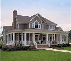 colonial style house exterior of a colonial style house the wrap around porch is a