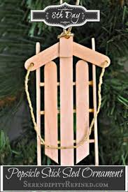 wood sled ornaments made out of popsicle sticks