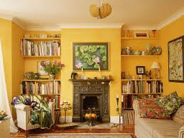 country style living room with fireplace and using yellow wall