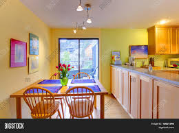 Purple Kitchen Happy Yellow And Purple Kitchen And Dining Table Stock Photo