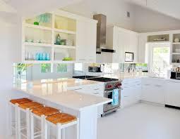 white cabinets black countertops backsplash minimalistic kitchen