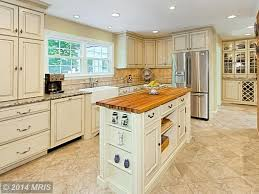 traditional kitchen with kitchen island u0026 stone tile in clifton