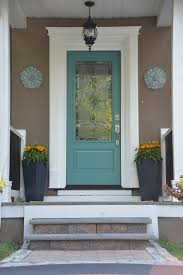 decorating interesting outdoor potted plants with white door