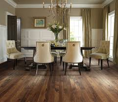 floor art with dark wood dining table dining room traditional and
