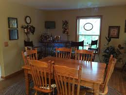 country dining room with hardwood floors u0026 bar cart in manly ia