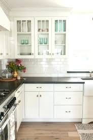 white overhead kitchen cabinets with frosted glass door inserts