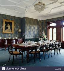 white tudor ceiling in large country dining room with blue carpet
