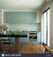 modern blue kitchen pastel blue fitted units in modern white kitchen with black table