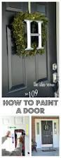 front door black paint doors brick wall traditional exterior home