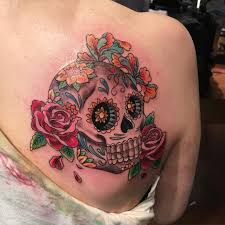 mexican skull tattoo with flowers on woman u0027s back sugar skull