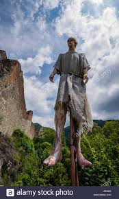 Vlad The Impalers Castle by Vertical Impalement Scene In Front Of Poenari Castle On Plateau Of