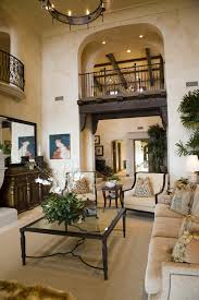 47 beautifully decorated living room designs view of balcony from two story living room in mediterranean style home