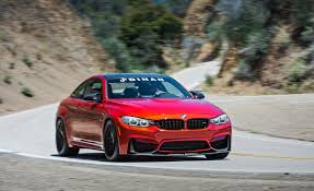 red bmw m4 2015 bmw m4 coupe pictures photo gallery car and driver