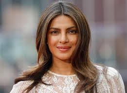 midi haircut the 32 best medium and shoulder length hairstyles purewow