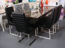 black marble dining table with stainless steel legs