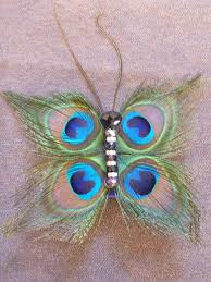 peacock feather butterfly hair clip by absolutelyfascinated on
