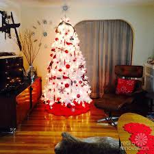 white christmas tree with red lights u2013 happy holidays