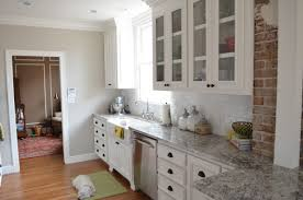 superior sample of off white kitchen cabinets with dark floors kitchen white wooden kitchen cabinet on laminate flooring with grey granite countertop and grey wall paint off