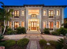 mediterranean home builders exquisite home exterior features a pale gray stucco exterior and a