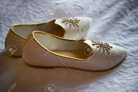 wedding shoes india image of men s indian wedding shoes on a bed stock photo picture