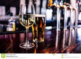 close up of a glass of wine and a beer stock photo image 66153785