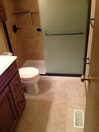 bathroom dark merola tile wall with rain shower and kohler shower