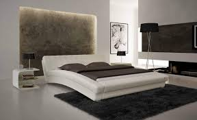 curved bed frame modern curved bed with padded white frame and leather tables