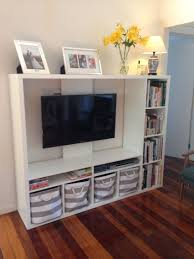 ikea lapland tv unit with books and storage baskets living room