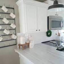 sherwin williams kitchen cabinet paint greige kitchen cabinets