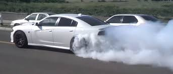 charger hellcat burnout this charger hellcat owner just pulled a massive burnout in front of