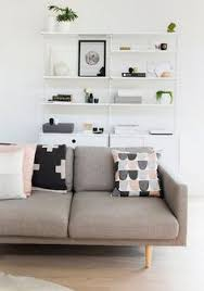 black and white living room with ikea sofa and warming grey tan