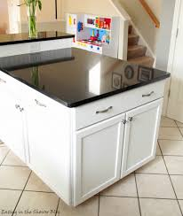 adding an island to an existing kitchen black and white kitchen remodel with painted cabinets