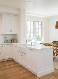 how to clean a white kitchen sink a stunning white kitchen peninsula boasts a farmhouse sink with a