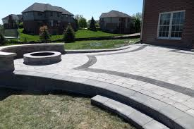 Raised Patio Pavers by Raised Unilock Pisa Ii Patio With A Fire Pit And Seat Wall Pavers