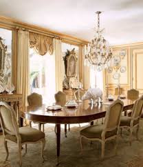 traditional dining room chandelier and beige and gold accent and