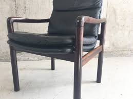 mid century danish leather armchair with lacquered rosewood frame