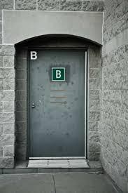 Plain Exterior Doors Gray Metal Exterior Door Marked With The Letter B Door And Window