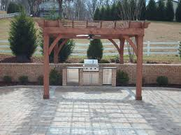 Flagstone Patio With Pergola Stacked Stone Outdoor Kitchen Cabinet With Brown Wooden Pergola On