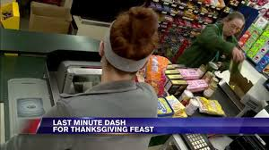 shoppers make last minute dash to grocery stores before thanksgiving