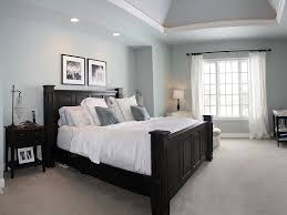 traditional master bedroom with crown molding u0026 carpet in