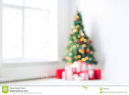 room with christmas tree and presents background stock photo