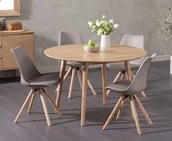 round oak kitchen table 120cm round oak dining table with oscar faux leather round leg chairs