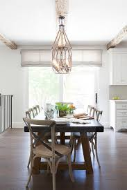zinc top dining table with wood and leather dining chairs