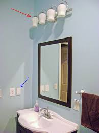 Bathroom Light Fixtures With Outlet by How To Finish A Basement Bathroom Vanity Light Wiring